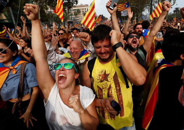 People celebrate after the Catalan regional parliament declares the independence from Spain in Barcelona, Spain, October 27, 2017.