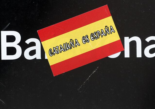 A sticker reading Catalonia is Spain is seen in Sant Jaume Square outside the Generalitat Palace, the Catalan regional government headquarters in Barcelona, Spain, October 30, 2017.