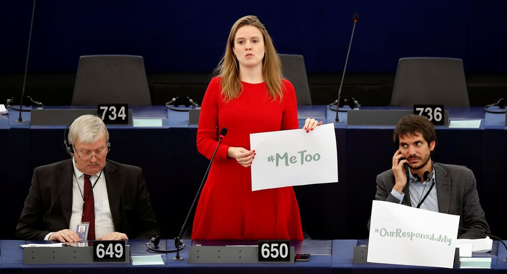 European Parliament member Terry Reintke (C) holds a placard with the hashtag MeToo during a debate to discuss preventive measures against sexual harassment and abuse in the EU at the European Parliament in Strasbourg, France, October 25, 2017.