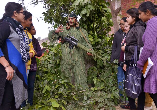 An Indian army soldier explains the use of a Sniper Rifle to university students (File)