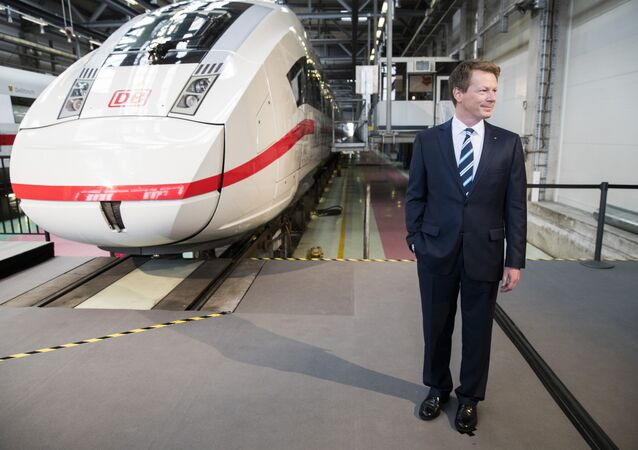 Richard Lutz, CEO of the German railway operator Deutsche Bahn (DB) poses for a picture in front of an Inter City Express 4 train prior to the company's annual results news conference in Berlin on March 23, 2017.