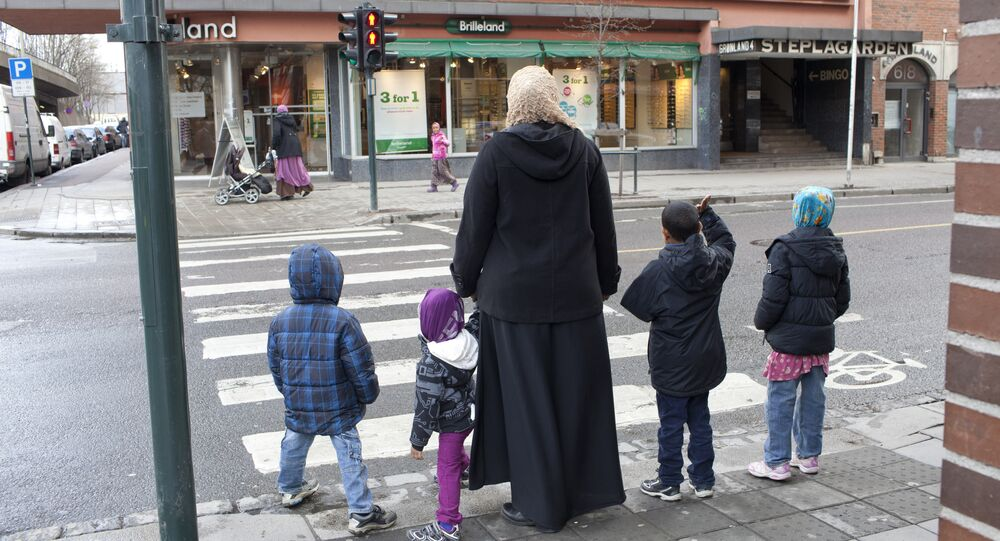 A norwegian muslim family is pictured at a crossroad in Oslo on April 21, 2012