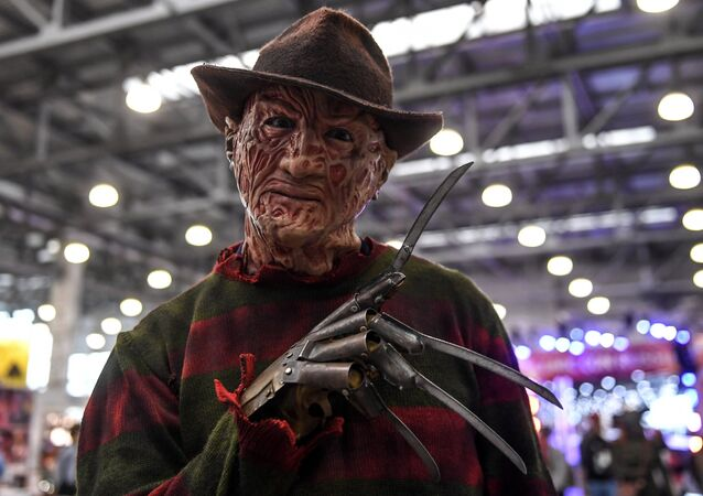 Man in Freddie Krueger costume at a comic convention