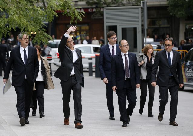Fired Catalan Cabinet members arrive at the national court in Madrid, Spain, Thursday, Nov. 2, 2017. From left to right are, Joaquim Forn, Dolors Bassa i Coll, Raul Romeva, Carles Mundo, Jordi Turull, Meritxell Borras and Josep Rull.