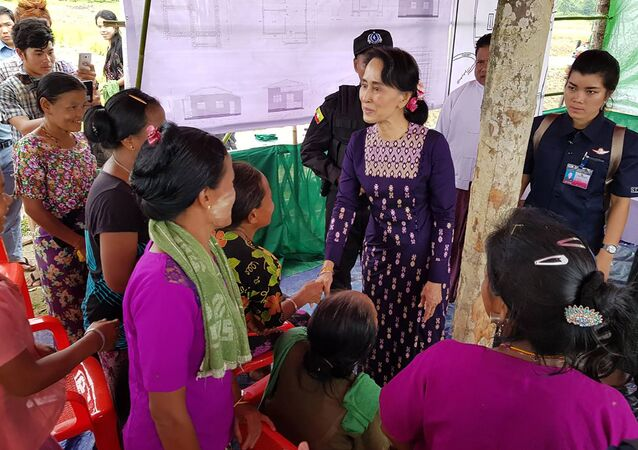 Myanmar State Counselor Aung San Suu Kyi (C) meets with Myo ethnic people in northern Maungdaw, Myanmar's Rakhine State
