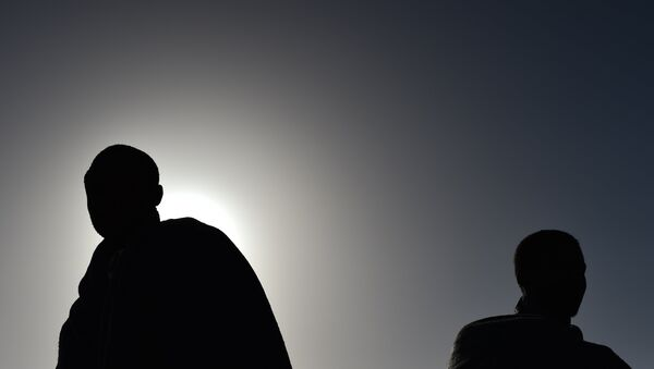 Men at the Libyan coast. (File) - Sputnik International