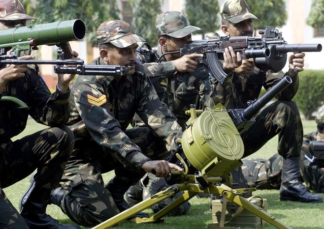 Indian army soldiers display a selection of the latest weapons including a Multi-shot grenade launcher, AK47 Kalashnikov rifles and a Flame Launcher at an Infantry Weapons Equipment display in New Delhi. (File)