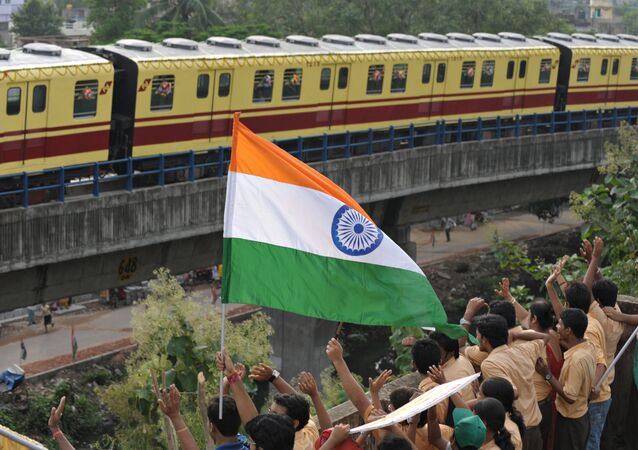 (File) Indian school students wave to greet a Kolkata Metro coach during its inaugural run in Kolkata on August 22, 2009