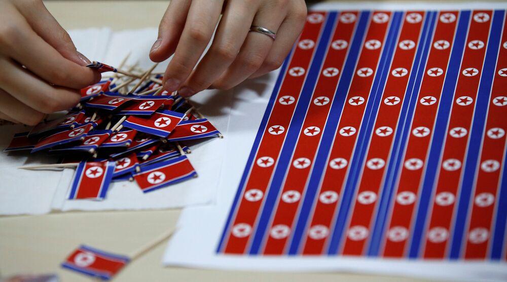 A member of Japan's North Korea fan club called sengun-joshi, or military-first girls, makes toothpick North Korean flags in Tokyo, Japan October 29, 2017