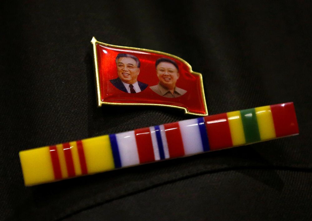 A North Korea fan wears a pin of North Korea founder Kim Il Sung and late leader Kim Jong Il during a North Korea fan event in Tokyo, Japan October 29, 2017