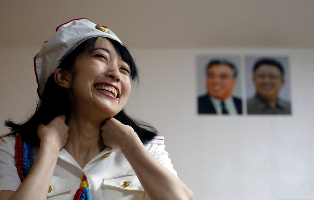 Chunhun, the leader of Japan's North Korea fan club called sengun-joshi, or military-first girls, smiles as she practices a Moranbong Band dance in front of portraits of North Korea founder Kim Il Sung and late leader Kim Jong Il in Tokyo, Japan October 22, 2017. Picture taken October 22, 2017