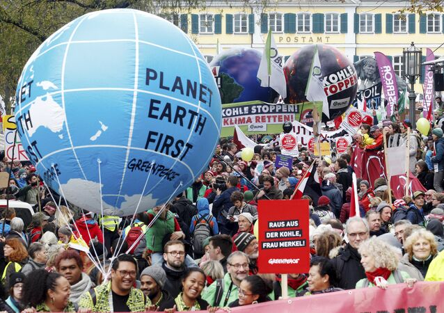 Protestors demand the implementation of the climate change convention in Bonn, Germany, Saturday, Nov. 4, 2017. The Climate summit starts Monday Nov. 6, in Bonn.