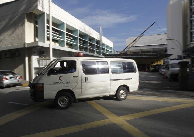 An ambulance comies out of the forensic department at Kuala Lumpur Hospital in Kuala Lumpur, Malaysia, Saturday, Feb. 25, 2017