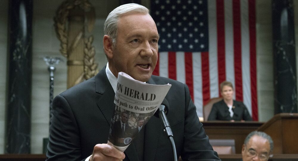 This image released by Netflix shows Kevin Spacey in a scene from House Of Cards. Netflix says it's suspending production on House of Cards following harassment allegations against Spacey