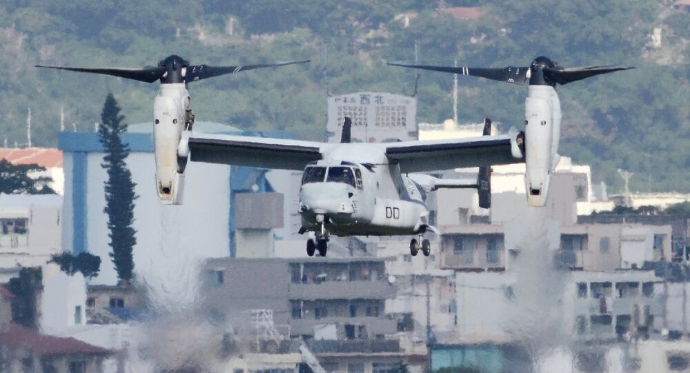 An MV-22 Osprey aircraft flies at the Marine Corps Air Station Futenma in Ginowan, Okinawa prefecture (File)