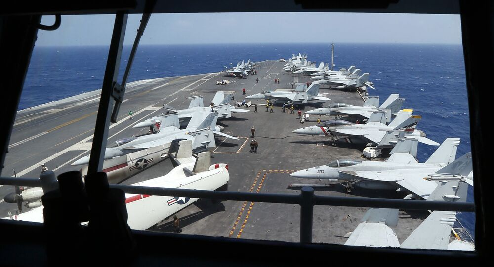 Fighter jets on board the U.S. Navy aircraft carrier USS Carl Vinson (CVN 70) are prepared for patrols off the disputed South China Sea Friday, March 3, 2017