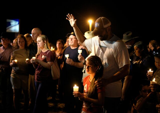 Ramiro and Sofia Martinez attend a candle light vigil after a mass shooting at the First Baptist Church in Sutherland Springs, Texas, U.S., November 5, 2017