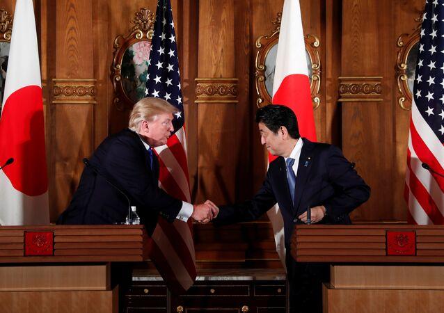 U.S. President Donald Trump and Japan's Prime Minister Shinzo Abe shake hands during a news conference at Akasaka Palace in Tokyo, Japan, November 6, 2017