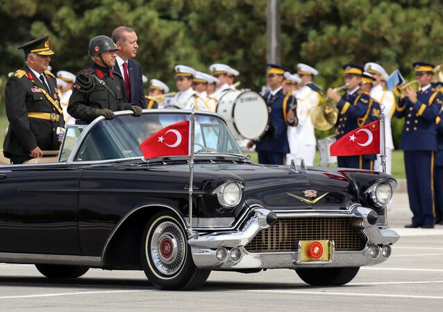 Turkish President Recep Tayyip Erdogan, right, and Chief of Staff Gen. Necdet Ozel, left, inspect the military on Victory Day in Ankara, Turkey, Saturday, Aug. 30, 2014.