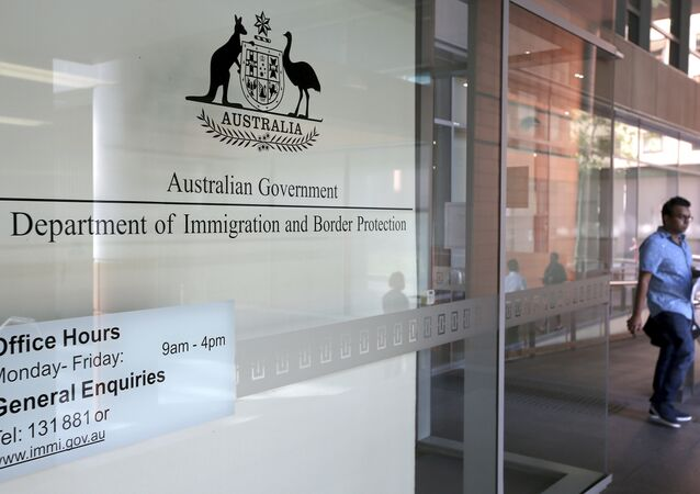 A man leaves the Department of Immigration and Border Protection offices in Sydney, Thursday, April 20, 2017.