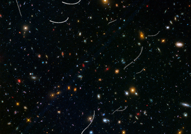This Hubble photo of a random patch of sky is part of a survey called Frontier Fields. Asteroid trails appear as curved or S-shaped streaks.