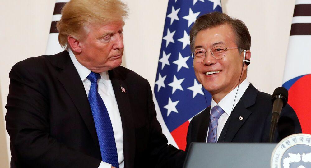 US President Donald Trump and South Korea's President Moon Jae-in shake hands at a news conference at South Korea's presidential Blue House in Seoul, South Korea, November 7, 2017