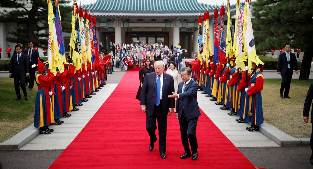 U.S. President Donald Trump walks with South Korea's President Moon Jae-in during a welcoming ceremony at the Presidential Blue House in Seoul, South Korea, November 7, 2017