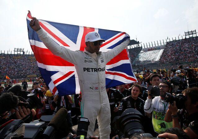 Mercedes' Lewis Hamilton celebrates after winning the World Championship