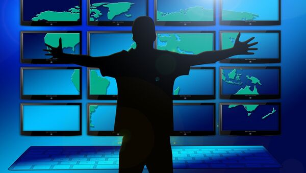 A silhouette of a man in front of multiple screens - Sputnik International