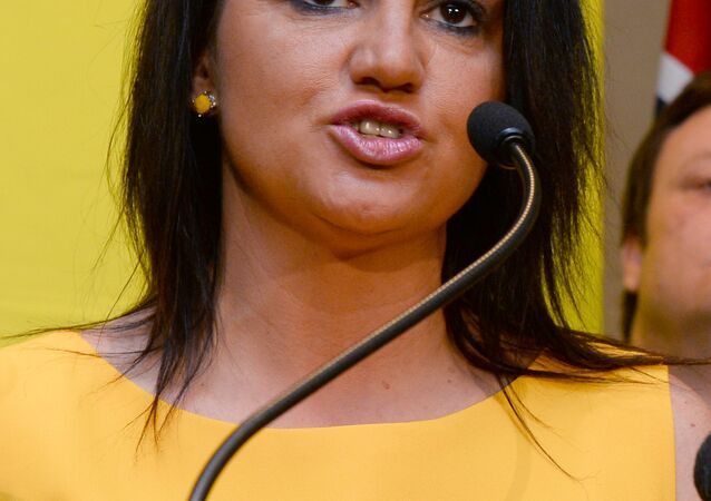 Senator Jacqui Lambie of the Palmer United Party (PUP) speaks during a press conference in Sydney on October 10, 2013.