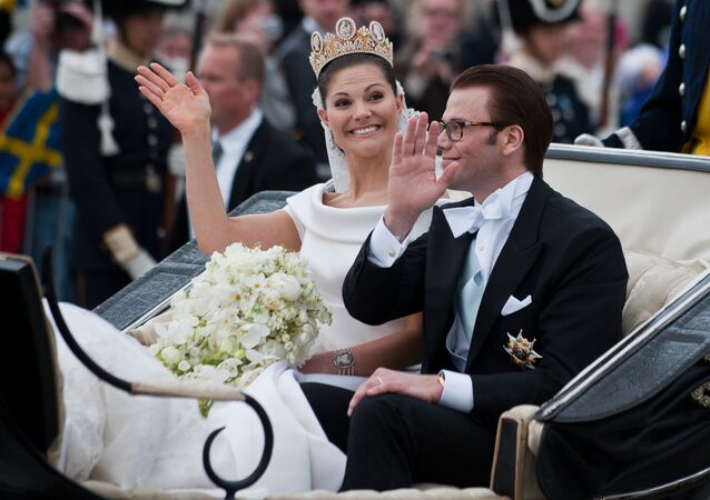 Crown Princess Victoria of Sweden, Duchess of Vastergotland, and her husband Prince Daniel, Duke of Vastergotland wave from a carriage following their wedding at the cathedral on June 19, 2010 in Stockholm