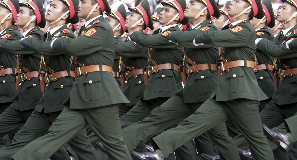 In this Sept. 2, 2015, file photo, Vietnamese soldiers march during a military parade in Hanoi, Vietnam.