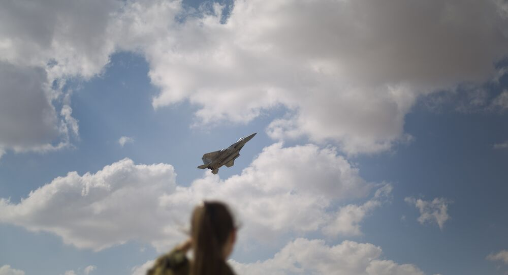 In this Wednesday, Nov. 8, 2017 photo, An Israeli soldier looks at an F-15s of the Knights of the twin tail 133 squadron takes off from Ovda airbase near Eilat, southern Israel,during the 2017 Blue Flag exercise. Israel's military is holding the largest ever air drill of its kind with pilots from eight countries simulating combat scenarios. It said Thursday that Germany, India and France are taking part for the first time in the two week drill codenamed blue flag, held every two years.