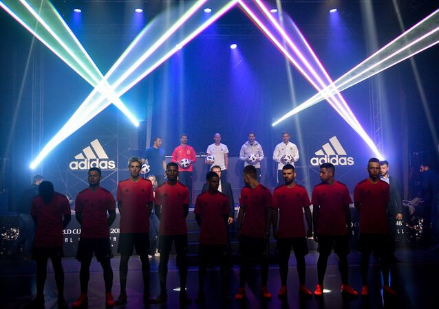 From L on the stage: Alessandro Del Piero, Xabi Alonso, Real Madrid's French coach Zinedine Zidane, Kaka and Lukas Podolski pose with the official match balls for the 2018 World Cup football tournament, named Telstar 18, during the unveiling ceremony in Moscow