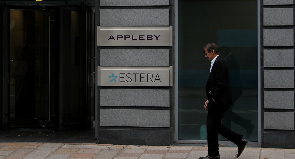 A man walks past the offices of Appleby in St Helier, Jersey, Britain November 7, 2017