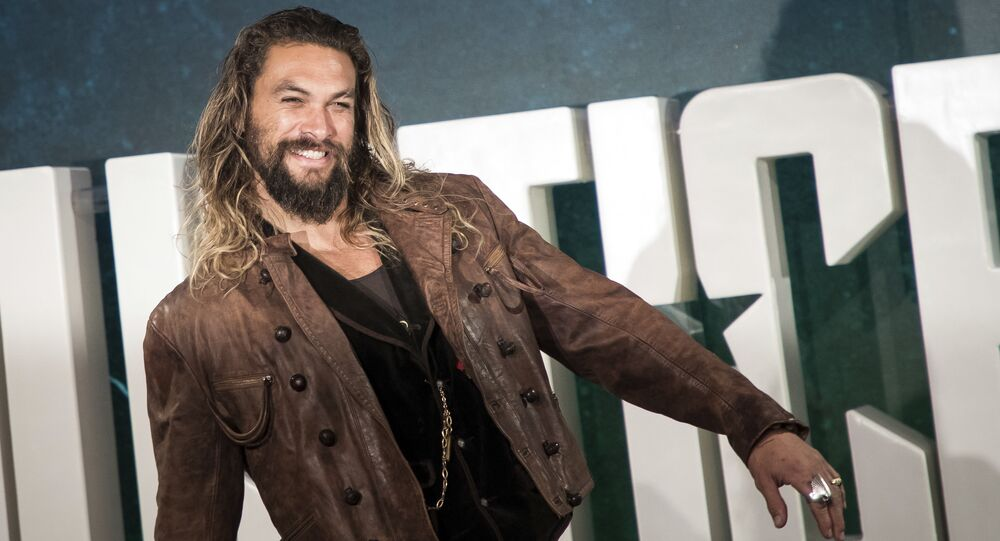 Actor Jason Momoa poses for photographers upon arrival at a photo call to promote the film 'Justice League', in London, Saturday, Nov. 4, 2017