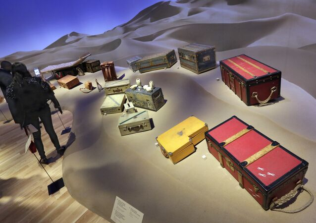 Expedition trunks, including a 1929 special photographer's trunk in Vuittonite canvas, foreground right, are displayed as part of the Volez, Voguez, Voyagez, Louis Vuitton exhibit, in the former American Stock Exchange building, in New York Financial District, Monday, Nov. 6, 2017