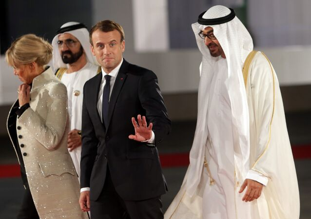 French President Emmanuel Macron gestures as he is welcomed by Abu Dhabi Crown Prince Sheikh Mohammed bin Zayed al-Nahyan and Prime Minister and Vice-President of UAE and Ruler of Dubai Sheikh Mohammed bin Rashid al-Maktoum upon Macron's arrival with his wife at the Louvre Abu Dhabi, in Abu Dhabi, UAE, November 8, 2017