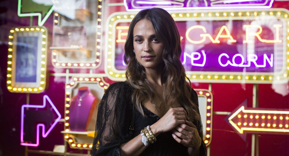 Actress Alicia Vikander arrives for a ribbon cutting ceremony of a Bulgari pop-up store at the Galleries Lafayette department store in Paris, Tuesday, July 4, 2017