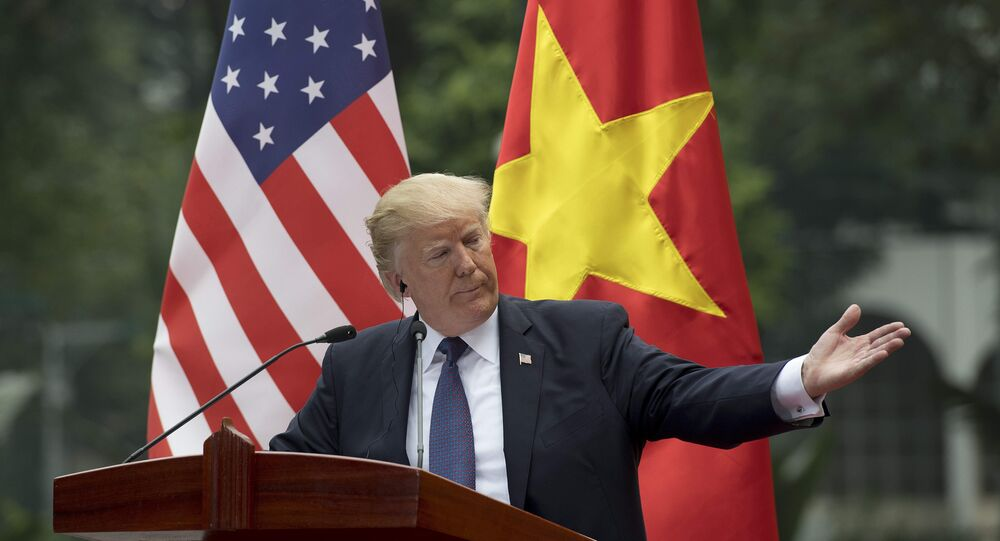 US President Donald Trump talks during a joint press conference with Vietnamese President Tran Dai Quang in Hanoi on November 12, 2017
