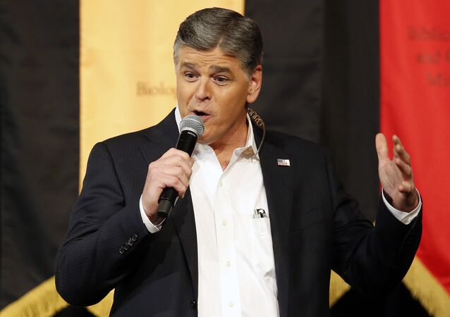In this March 18, 2016 file photo, Fox News Channel's Sean Hannity speaks during a campaign rally for Republican presidential candidate, Sen. Ted Cruz, R-Texas, in Phoenix.
