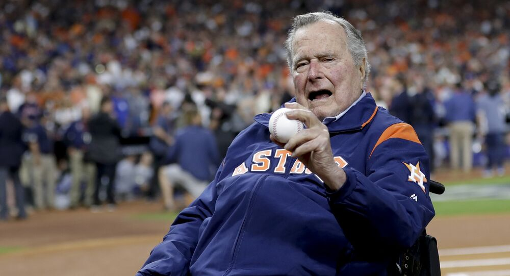Former President George H.W. Bush waits on the field for first pitch ceremony before Game 5 of baseball's World Series against the Los Angeles Dodgers Sunday, Oct. 29, 2017, in Houston