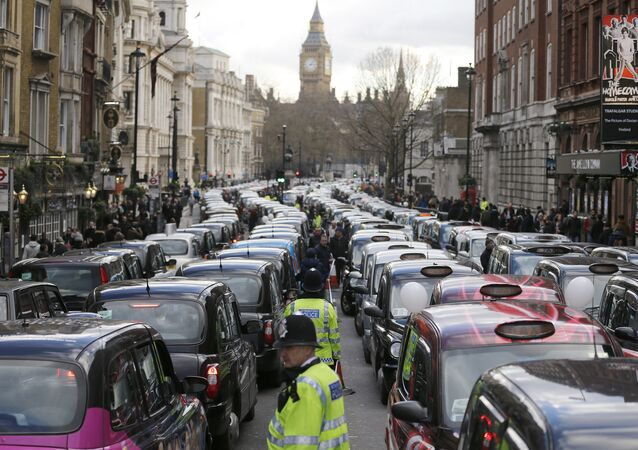 London taxis block the roads in central London, Wednesday, Feb. 10, 2016. Drivers are concerned with unfair competition from services such as Uber.