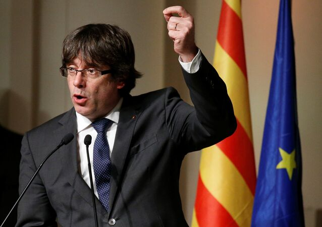 Former Catalan leader Carles Puigdemont gestures while delivering a speech to Catalan mayors in Brussels, Belgium, November 7, 2017.