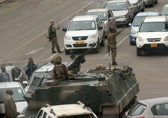 Military vehicles and soldiers patrol the streets in Harare, Zimbabwe, November 15,2017