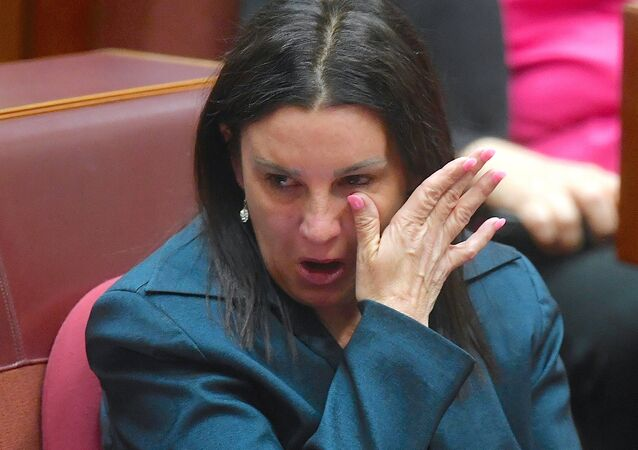 Jacqui Lambie, an independent and outspoken senator for the island state of Tasmania, reacts after delivering a statement regarding her resignation in the Senate chamber at Parliament House in Canberra, Australia, November 14, 2017.