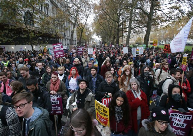 Demonstrators hold up placards at a protest march through central London on November 19, 2016 called by the National Union of Students and University College Union to demand free, quality further and higher education, accessible to all