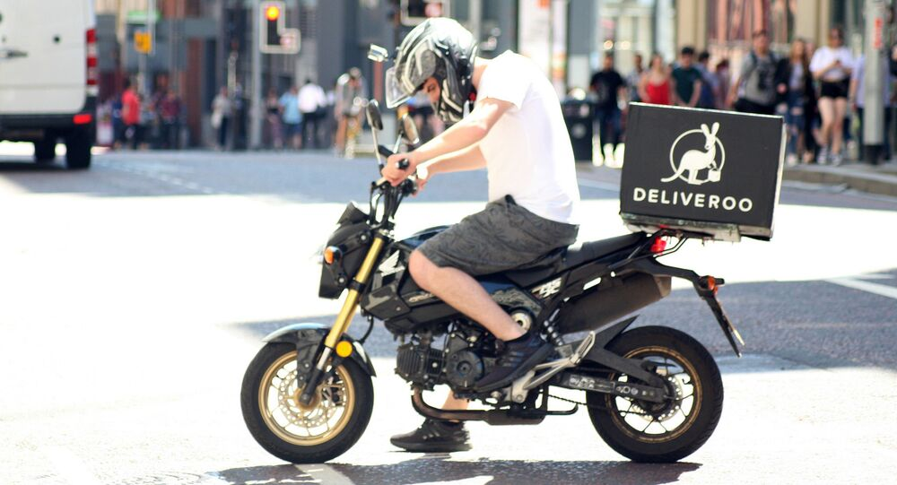 Deliveroo biker - Deliveroo delivery drive on a motorbike in Manchester