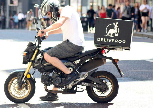 Deliveroo biker - Deliveroo delivery drive on a motorbike in Manchester