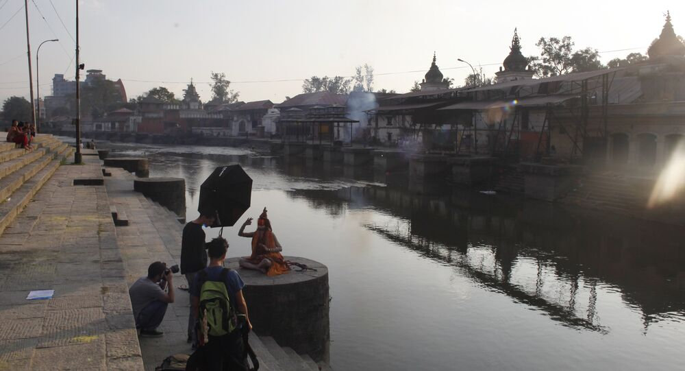 A Hindu holy man poses for a photographer on the bank of the Bagmati River near the Pashupatinath Hindu temple in Kathmandu, Nepal. (File)